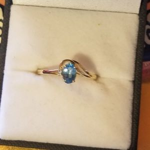 14k blue topaz with a small diamond ring
